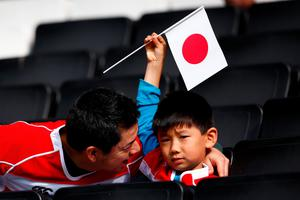 MILTON KEYNES, ENGLAND - OCTOBER 03:  A young Japan fan sits with his father prior to the 2015 Rugby World Cup Pool B match between Samoa and Japan at Stadium mk on October 3, 2015 in Milton Keynes, United Kingdom.  (Photo by Laurence Griffiths/Getty Images)