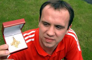 Portadown central midfielder Richard Clarke with his 1999 cup winners medal.