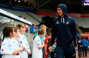 SWANSEA, WALES - OCTOBER 01:  Jack Cork of Swansea City arrives at the stadium prior to kick off during the Premier League match between Swansea City and Liverpool at Liberty Stadium on October 1, 2016 in Swansea, Wales.  (Photo by Stu Forster/Getty Images)