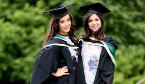 Graduating from Ulster University today with degree both in PGCE Primary are Krissy Payne from Bangor and Hannah Petherick from Newtownards. Pic By Paul Moane / Aurora PA
