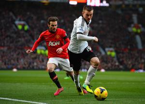 MANCHESTER, ENGLAND - FEBRUARY 09:  Ryan Tunnicliffe of Fulham competes with Juan Mata of Manchester United during the Barclays Premier League match between Manchester United and Fulham at Old Trafford on February 9, 2014 in Manchester, England.  (Photo by Michael Regan/Getty Images)