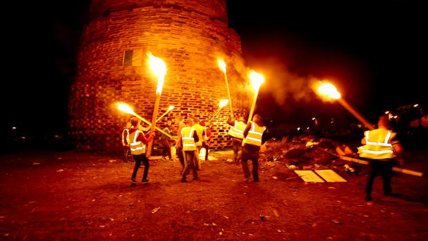 Bonfire builders get to work lighting the Ballymacash bonfire in Lisburn. William Cherry/Presseye.