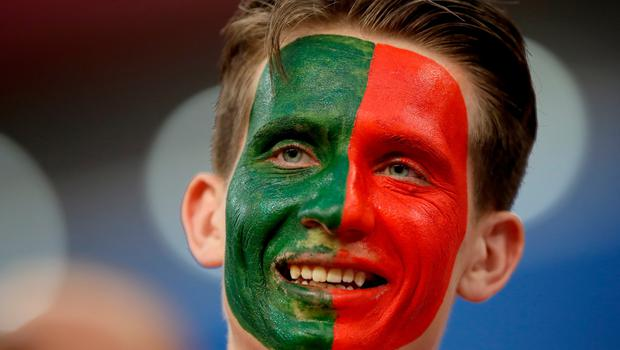 SARANSK, RUSSIA - JUNE 25:  A Portugal fan enjoys the pre match atmosphere prior to the 2018 FIFA World Cup Russia group B match between Iran and Portugal at Mordovia Arena on June 25, 2018 in Saransk, Russia.  (Photo by Clive Brunskill/Getty Images)