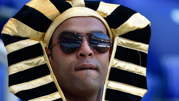 An Egypt fan waits for the start of the Russia 2018 World Cup Group A football match between Saudi Arabia and Egypt at the Volgograd Arena in Volgograd on June 25, 2018.