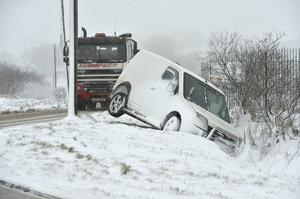 General view of a Transit van which skidded off the road on the Hannahstown hill. Mandatory Credit © Stephen Hamilton