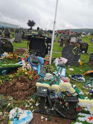 The damage caused to the grave of Warren Crossan in Milltown Cemetery. Photo Pacemaker Press