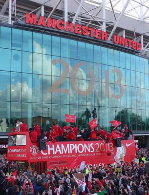 MANCHESTER, ENGLAND - MAY 13:  Players appear on the open topped bus outside Old Trafford during the Manchester United Premier League winners parade on May 13, 2013 in Manchester, England.  (Photo by Alex Livesey/Getty Images)
