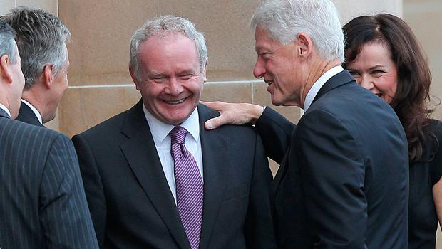 File photo dated 29/09/10 of former US President Bill Clinton (right)arriving at University of Ulster Magee Campus in Derry to meet First Minister Peter Robinson and Deputy First Minister Martin McGuinness (centre). Julien Behal/PA Wire