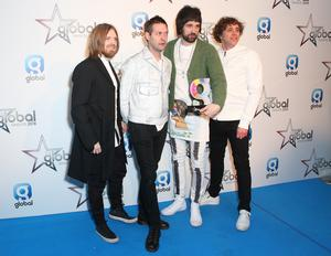 Chris Edwards, Tom Meighan, Serge Pizzorno and Ian Matthews in 2018 (Isabel Infantes/PA)