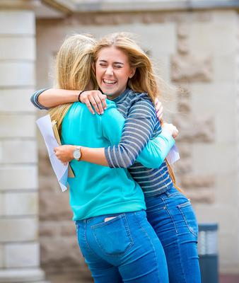 Niamh Hanna and Jane McNulty celebrate as they receive A-Level results at St Dominic's Grammar School for Girls on August 17th 2017 (Photo by Kevin Scott / Belfast Telegraph)