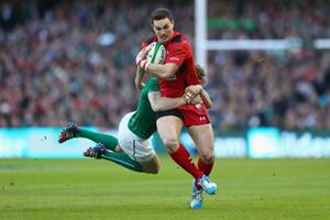 DUBLIN, IRELAND - FEBRUARY 08:  George North of Wales is tackled by Andrew Trimble (L) of Ireland during the RBS Six Nations match between Ireland and Wales at the Aviva Stadium on February 8, 2014 in Dublin, Ireland.  (Photo by Michael Steele/Getty Images)