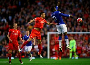 Dejan Lovren of Liverpool makes a challenge on Romelu Lukaku of Everton during the Barclays Premier League match between Liverpool and Everton at Anfield, April 20, 2016, Liverpool, England  (Photo by Clive Brunskill/Getty Images)