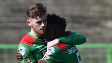 Ruaidhri Donnelly is congratulated as he scored twice for the Glens at the Oval.
