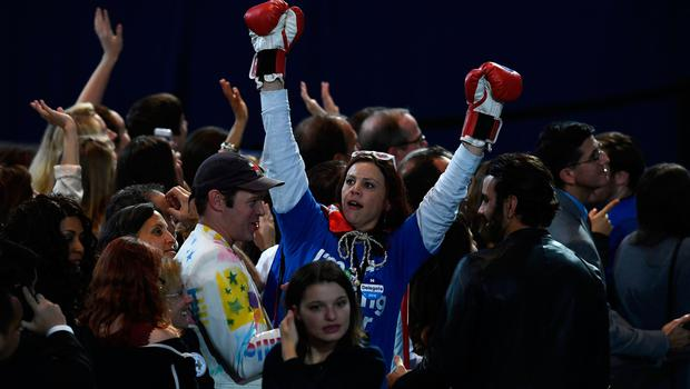 A supporter of Democratic presidential nominee Hillary Clinton raises her arms with boxing gloves on during election night at the Jacob K. Javits Convention Center in New York on November 8, 2016.  / AFP PHOTO / Jewel SAMADJEWEL SAMAD/AFP/Getty Images