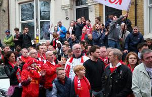LIVERPOOL, ENGLAND - APRIL 13:  Crowds wait for the arrival of the Liverpool Team coach prior to the Barclays Premier League match between Liverpool and Manchester City at Anfield on April 13, 2014 in Liverpool, England.  (Photo by Alex Livesey/Getty Images)