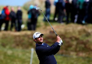 Alexander Levy plays his approach to the 8th green during day one of the Dubai Duty Free Irish Open at Royal County Down Golf Club, Newcastle. PRESS ASSOCIATION Photo. Picture date: Thursday May 28, 2015. See PA story GOLF Irish. Photo credit should read: Brian Lawless/PA Wire. RESTRICTIONS: Editorial use only. No commercial use. No false commercial association. No video emulation. No manipulation of images.