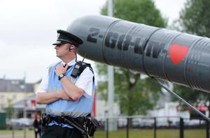 17/6/2013/ PACEMAKER PRESS. A PSNI officer keeps watch over an anti-G8 love missile near  patrol the G8 protest camp site this afternoon in Enniskillen with the G8 summit taking place at the near by Lough Erne resort, Northern Ireland. Picture Charles McQuillan/Pacemaker.