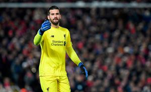 Alisson's late save helped Liverpool into the knockout stages of the Champions League.