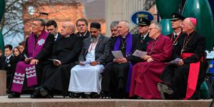 The Mayor of Greater Manchester Andy Burnham (second left) and the Mayor of the Liverpool Steven Rotheram (fourth left) sit with faith leaders, during the 25th anniversary service of the Warrington bombing, on Bridge Street, attended by the families of victims of the attack, faith leaders and representatives of the British and Irish governments. PRESS ASSOCIATION Photo. Picture date: Tuesday March 20, 2018. See PA story MEMORIAL Warrington. Photo credit should read: Peter Byrne/PA Wire