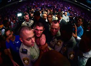 Khabib Nurmagomedov of Russia is escorted out of the arena after defeating Conor McGregor (Photo by Harry How/Getty Images)