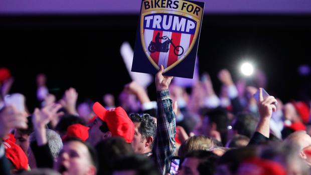 "NEW YORK, NY - NOVEMBER 08:  An attendee holds up a sign in support of Republican presidential nominee Donald Trump that reads ""Bikers For Trump"" during the election night event at the New York Hilton Midtown on November 8, 2016 in New York City. Americans today will choose between Republican presidential nominee Donald Trump and Democratic presidential nominee Hillary Clinton as they go to the polls to vote for the next president of the United States.  (Photo by Spencer Platt/Getty Images)"