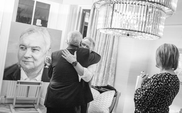 Eamonn shares an embrace with artist Colin Davidson. Photo by Paul McConville for Content88