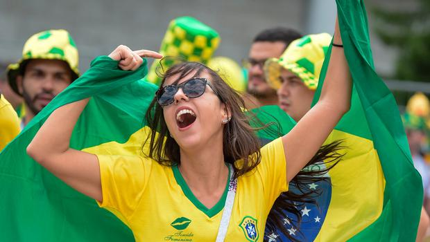 Brazil Fans cheer as they await his team arrival at Mirage Hotel in Kazan on July 5, 2018, for their Russia 2018 World Cup round of 8 football match against Belgium. Pic / AFP PHOTO / LUIS ACOSTALUIS ACOSTA/AFP/Getty Images