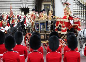 LONDON, ENGLAND - MAY 08:  Queen Elizabeth II travels by coach to the State Opening of Parliament  on May 8, 2013 in London, England. Queen Elizabeth II will unveil the coalition government's legislative programme in a speech delivered to Members of Parliament and Peers in The House of Lords. Proposed legislation is expected to be introduced on toughening immigration regulations, capping social care costs in England and setting a single state pension rate of 144 GBP per week.  (Photo by Peter Macdiarmid/Getty Images)