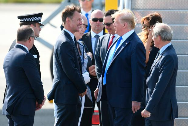 US President Donald Trump is greeted by Foreign Secretary Jeremy Hunt (left), as he and his wife Melania arrive at Stansted Airport in Essex, aboard Air Force One for the start of his three day state visit to the UK. PRESS ASSOCIATION Photo. Picture date: Monday June 3, 2019. See PA story ROYAL Trump. Photo credit should read: Joe Giddens/PA Wire