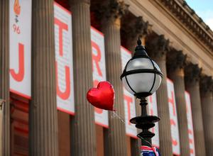 Tributes are left outside Liverpool's Saint George's Hall as thousands of people gather to attend a vigil for the 96 victims of the Hillsborough tragedy on April 27, 2016 in Liverpool, England. (Photo by Christopher Furlong/Getty Images)