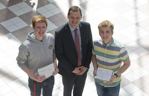 A Level student's at  Banbridge academy, Co Down celebrate getting their results. Pictured are Mark Turkington,  Jonathan warnock  and the Principle of Banbridge Academy Mr McLoughlin. Picture Mark Marlow
