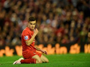 Liverpool's Brazilian midfielder Philippe Coutinho reacts after missing a shot on goal during the English Premier League football match between Liverpool and Everton at Anfield in Liverpool, north west England on April 20, 2016. AFP/Getty Images