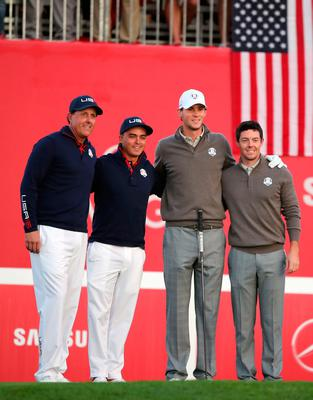 (From left to right) USA's Phil Mickelson and Rickie Fowler pose for a picture with Europe's Thomas Pieters and Rory McIlroy ahead of their Fourballs match on day two of the 41st Ryder Cup at Hazeltine National Golf Club in Chaska, Minnesota, USA. PRESS ASSOCIATION Photo. Picture date: Saturday October 1, 2016. See PA story GOLF Ryder. Photo credit should read: Peter Byrne/PA Wire. RESTRICTIONS: Use subject to restrictions. Editorial use only. No commercial use. Call +44 (0)1158 447447 for further information.