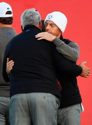 CHASKA, MN - OCTOBER 01: captain Darren Clarke of Europe hugs Rory McIlroy on the first tee during morning foursome matches of the 2016 Ryder Cup at Hazeltine National Golf Club on October 1, 2016 in Chaska, Minnesota.  (Photo by Ross Kinnaird/Getty Images)