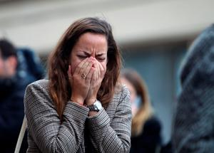 A women shows emotion outside Le Carillon bar, Paris, one of the venues for the attacks in the French capital which are feared to have killed around 127 people. PRESS ASSOCIATION Photo. Issue date: Saturday November 14, 2015. A state of emergency has been declared in France after a night of horror in the capital. There were two suicide attacks and a bombing near the Stade de France stadium, shootings at restaurants and a massacre inside a popular music venue in what is the worst violence to hit France since the Second World War. See PA story POLICE Paris. Photo credit should read: Steve Parsons/PA Wire