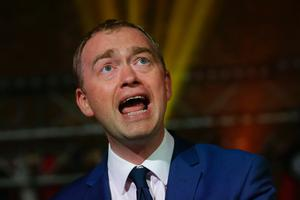 Liberal Democrats leader Tim Farron gestures as he speaks at an event to launch the party's general election manifesto in London on May 17, 2017. Britain goes to the polls to elect a new parliament in a general election on June 8. AFP/Getty Images