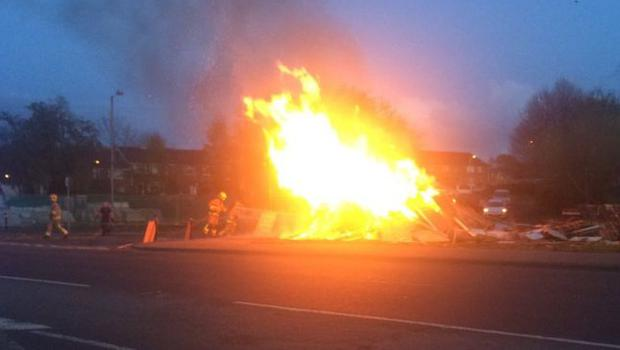 A bonfire in Milltown Road in south Belfast has been set on fire. Credit: BBC