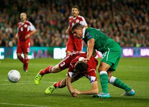 DUBLIN, IRELAND - SEPTEMBER 07:  Solomon Kvirkvelia of Georgia and Jonathan Walters of the Republic of Ireland battle for the ball during the UEFA EURO 2016 Group D qualifying match between Republic of Ireland and Georgia at Aviva Stadium on September 7, 2015 in Dublin, Ireland.  (Photo by Ian Walton/Getty Images)