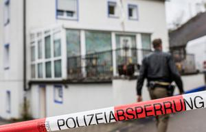 "Police investigators stand outside the house where a 49-year-old ""Reich citizen"" shot and wounded four policemen during a raid on October 20, 2016 in Georgensgmund, Germany. (Photo by Marc Mueller/Getty Images)"