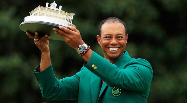 AUGUSTA, GEORGIA - APRIL 14: Tiger Woods of the United States celebrates with the Masters Trophy during the Green Jacket Ceremony after winning the Masters at Augusta National Golf Club on April 14, 2019 in Augusta, Georgia. (Photo by Mike Ehrmann/Getty Images)