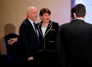 BELFAST, NORTHERN IRELAND - DECEMBER 17:  DUP leader in waiting Arlene Foster (C) jokes with party colleagues at the Park Avenue hotel ahead of the Democratic Unionist Party electoral college meeting on December 17, 2016 in Belfast, Northern Ireland. Arlene Foster, who will succeed Peter Robinson becomes the first female leader of the Democratic Unionist Party. No other nominations were put forward for the role of leader. Mrs Foster will also be appointed as the new Northern Ireland first minister in the coming weeks. The former Ulster Unionist Party member has enjoyed a rapid rise through the ranks of the DUP following her defection in 2004, twice standing in as temporary first minister for Peter Robinson in times of personal and political crisis. The DUP remain the largest political party within the provinces' Executive government.  (Photo by Charles McQuillan/Getty Images)