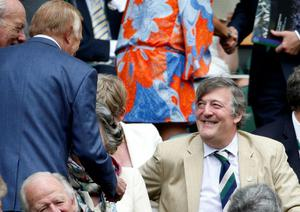 Sir Bruce Forsyth (left) meets Stephen Fry in the Royal Box on Centre Court during day Three of the Wimbledon Championships at The All England Lawn Tennis and Croquet Club, Wimbledon. PRESS ASSOCIATION Photo. Picture date: Wednesday June 26, 2013. See PA story TENNIS Wimbledon. Photo credit should read: Jonathan Brady/PA Wire. RESTRICTIONS: Editorial use only. No commercial use. No video emulation. No use with any unofficial third party logos.