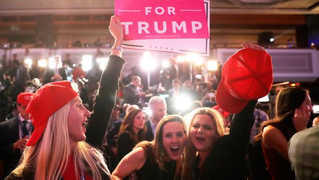 NEW YORK, NY - NOVEMBER 08:  People cheer at Republican presidential nominee Donald Trumps election night event at the New York Hilton Midtown on November 8, 2016 in New York City. Americans today will choose between Republican presidential nominee Donald Trump and Democratic presidential nominee Hillary Clinton as they go to the polls to vote for the next president of the United States.  (Photo by Chip Somodevilla/Getty Images)
