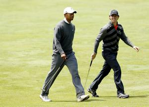 ARDMORE, PA - JUNE 14:  (L-R) Tiger Woods of the United States and Rory McIlroy of Northern Ireland walk up the 15th fairway during Round Two of the 113th U.S. Open at Merion Golf Club on June 14, 2013 in Ardmore, Pennsylvania.  (Photo by Scott Halleran/Getty Images)