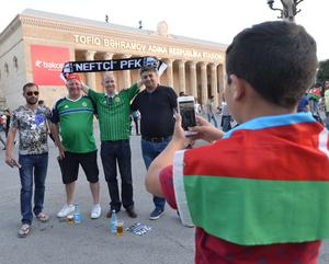 Who said football fans don't get along? An Azerbaijan fan takes a picture for some members of the GAWA.