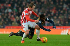 Stoke City's Glenn Whelan (left) and Arsenal's Joel Campbell battle for the ball during the Barclays Premier League match at the Britannia Stadium, Stoke.