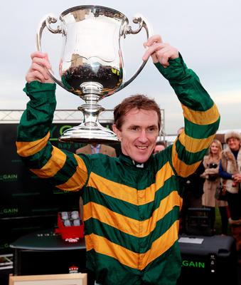 File photo dated 07-11-2013 of Tony McCoy celebrating claiming his 4000th winner on Mountain Tunes in the Weatherbys Novices' Hurdle at Towcester Racecourse, Northamptonshire.  PRESS ASSOCIATION Photo. Issue date: Friday April 24, 2015. Tony McCoy claimed his 4,000th winner over jumps in Britain and Ireland: Mountain Tunes, Towcester, November 7, 2013. See PA story RACING McCoy Factfile. Photo credit should read David Davies/PA Wire.