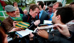 Jockey Tony McCoy signs racecards during the bet365 Jump Finale at Sandown Racecourse, Surrey. PRESS ASSOCIATION Photo. Picture date: Saturday April 25, 2015. See PA story RACING Sandown. Photo credit should read: David Davies/PA Wire