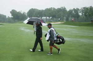 LOUISVILLE, KY - AUGUST 08:  Scott Stallings of the United States and his caddie Jon Yarborough walk across the tenth fairway during the weather-delayed second round of the 96th PGA Championship at Valhalla Golf Club on August 8, 2014 in Louisville, Kentucky.  (Photo by Warren Little/Getty Images)
