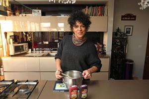 U105 Radio Presenter Carolyn Stewart cooking in the kitchen with some of her sauces that she has made.  Photo by Peter Morrison